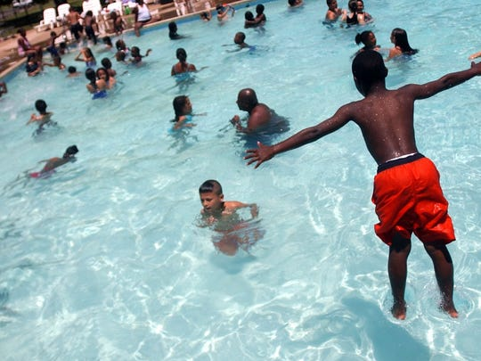 In this file photo, a swimmer plunges into the Lucy Park Pool. Summer camps through the city of Wichita Falls Parks and Recreation Department begin June 3 and include fun activities like trips to the Lucy Park pool and movie days.