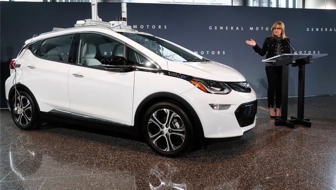 General Motors Chairman and Chief Executive Officer Mary Barra speaks next to a autonomous Chevrolet Bolt electric car Thursday, Dec. 15, 2016, in Detroit. General Motors has started testing fully autonomous vehicles on public roads around its technical center in suburban Detroit.