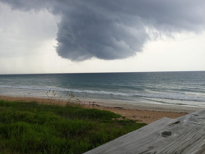 A massive, but magnificent gray cloud hovers over Flagler