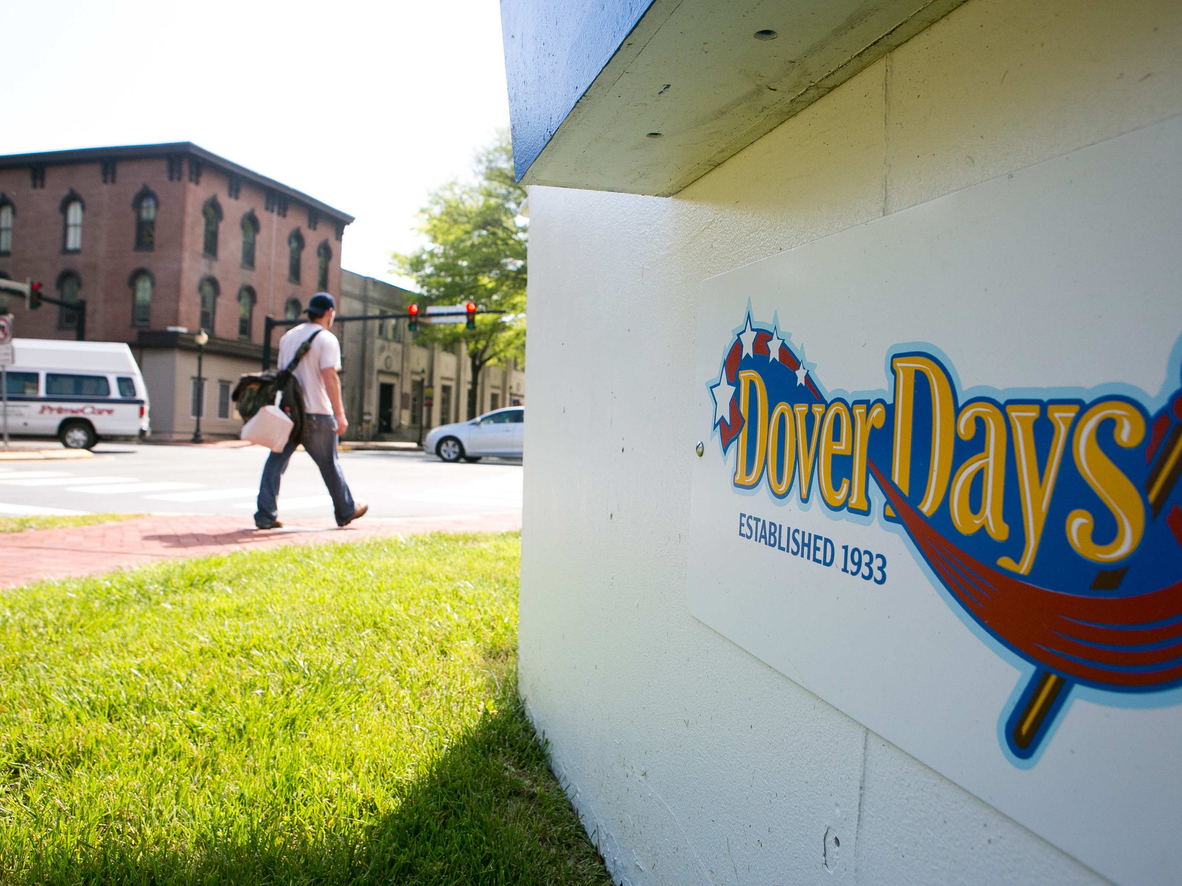 A pedestrian walks along Loockerman Street and South State Street in Dover. Heavy traffic is expected this weekend in Dover, with Vice President Joe Biden delivering the keynote address at the Delaware State University graduation, Wesley College having its commencement ceremony and Dover Days celebration being held.