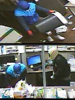 A burglar fills a trashcan with prescription medication during a break-in at River's Edge Pharmacy in November.