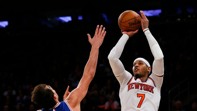 New York Knicks forward Carmelo Anthony makes the game winning shot against Philadelphia 76ers forward Dario Saric (9) during second half at Madison Square Garden. The New York Knicks defeated the Philadelphia 76ers 110-109.