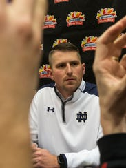 Ex-Notre Dame offensive coordinator Mike Sanford  answering