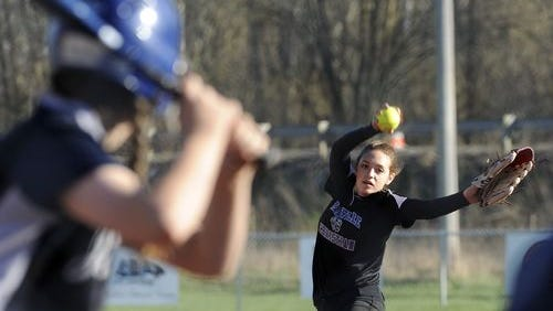Granville Christian Academy sophomore Chloe Brenneman delivers a pitch against Wellington earlier this season.