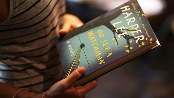Eden Sherman checks out a copy of 'Go Set a Watchman' by Harper Lee  at the Books and Books store in Coral Gables, Fla.