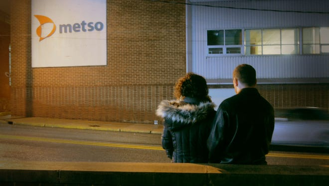 A couple listen to the Christmas whistle concert last year at METSO Minerals on Arch Street in York City. (Bil Bowden - For The York Dispatch)