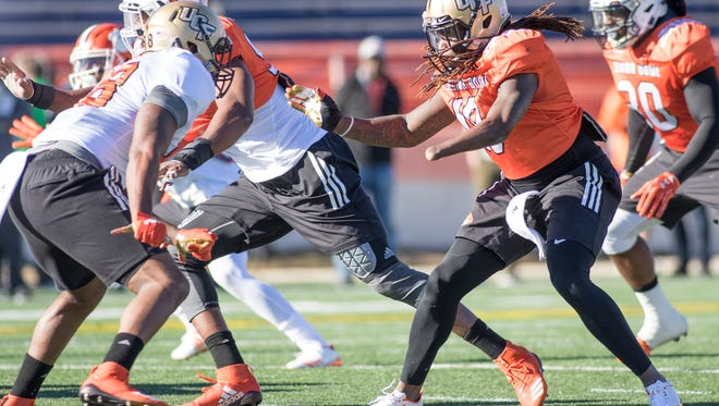 Shaquem Griffin (18) of UCF runs a drill during practice for the Senior Bowl in Mobile, Alabama on Tuesday, January 23, 2018.