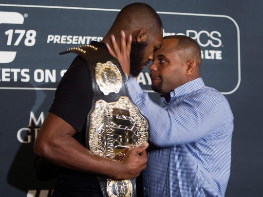 Challenger Daniel Cormier, right, prepares to shove UFC light heavyweight champion Jon Jones during a UFC press conference in August in Las Vegas.