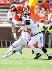 Clemson tight end Grant Radakovich jumps over an S.C. State player on a reception earlier this season.