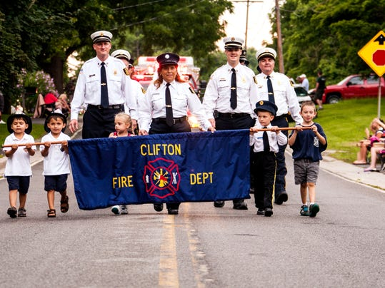 The Clifton FD firefighters and the future of the firefighters carry the banner with pride.