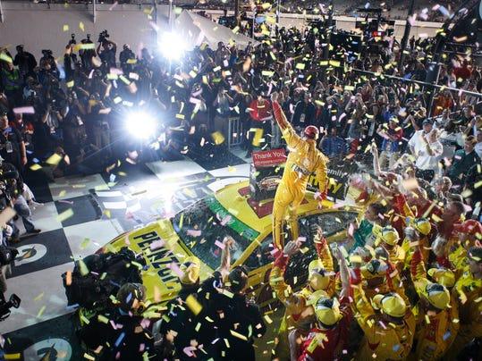 Joey Logano celebrates in Victory Lane after winning the NASCAR Sprint Cup auto race at Richmond International Raceway in Richmond, Va., Saturday April 26, 2014. (AP Photo/Richmond Times-Dispatch, Dean Hoffmeyer)