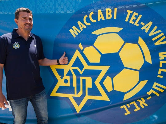 """FILE - In this Thursday, May 31, 2012 file photo, former midfielder Barcelona player and Maccabi Tel Aviv Coach Oscar Garcia poses for photographers in Tel Aviv, Israel. Garcia has quit his job, with the club saying Tuesday it was because of the """"current security situation"""" in Israel. The club said Garcia will be replaced by Pako Ayestaran, another Spaniard. (AP Photo/Ariel Schalit, File)"""