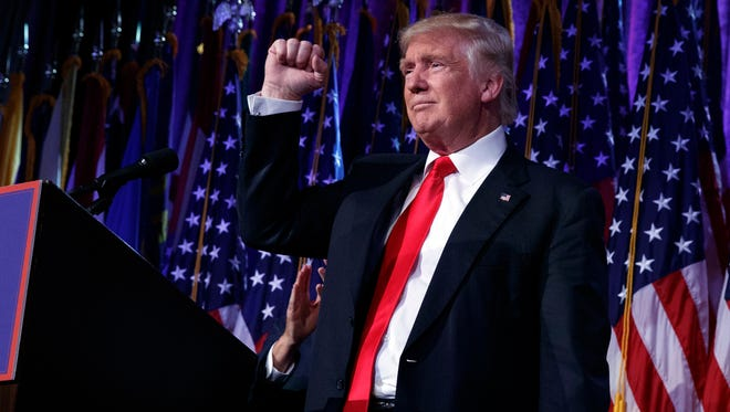 President Donald Trump pumps his fist during an election night rally in November 2016 in New York.