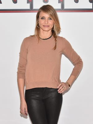 """Cameron Diaz attends the """"Annie"""" Cast Photo Call at Crosby Street Hotel on December 4, 2014 in New York City."""