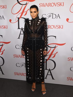 Kim Kardashian poses on the winners walk at the 2015 CFDA Fashion Awards at Alice Tully Hall at Lincoln Center on June 1, 2015 in New York City.