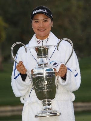 So Yeon Ryu holds the trophy after winning the ANA Inspiration in Rancho Mirage, April 2, 2017.
