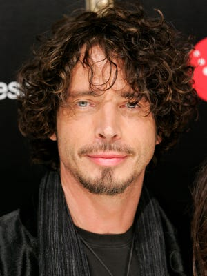 Singer Chris Cornell poses on the press line at a party honoring Timbaland in Los Angeles, Feb. 8, 2008.