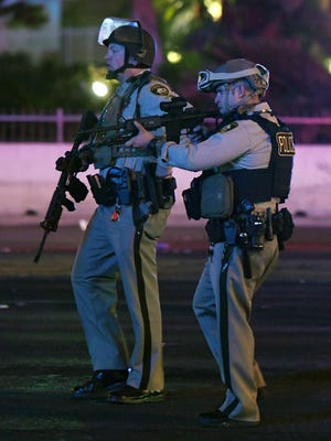 LAS VEGAS, NV - OCTOBER 02:  Las Vegas Metropolitan Police Department officers point their weapons at a car driving down closed Tropicana Ave. near Las Vegas Boulevard after a mass shooting at a country music festival nearby on October 2, 2017 in Las Vegas, Nevada.  A gunman has opened fire on a music festival in Las Vegas, leaving at least 20 people dead and more than 100 injured. Police have confirmed that one suspect has been shot. The investigation is ongoing. (Photo by Ethan Miller/Getty Images)