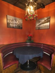 A cozy corner booth for conversation at Lucky Joe's