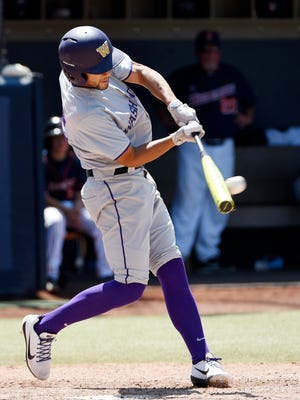 Washington's Kaiser Weiss hits a two-run double against Cal State Fullerton during the ninth inning of NCAA Super Regional game last Friday. The Oxnard High graduate has helped the Huskies reach the College World Series for the first time.