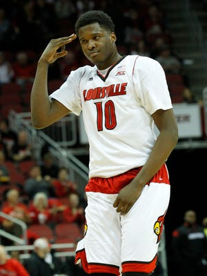 University of Louisville's Jaylen Johnson (10) reacts after making a three point shot against Savannah State during the second half of play at the KFC Yum! Center in Louisville, Kentucky, November 24, 2014.