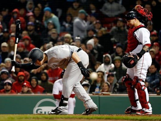 Apr 11, 2018; Boston, MA, USA; New York Yankees first baseman Tyler Austin (26) slams his bat before charging the mound during the seventh inning against the Boston Red Sox at Fenway Park.
