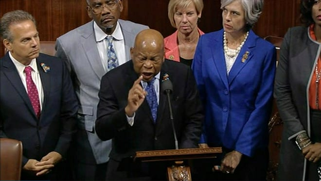 In this frame grab taken from AP video Georgia Rep. John Lewis leads more than 200 Democrats in demanding a vote on measures to expand background checks and block gun purchases by some suspected terrorists in the aftermath of last week's massacre in Orlando, Florida, that killed 49 people in a gay nightclub.  Rebellious Democrats shut down the House's legislative work on Wednesday, June 22, 2016, staging a sit-in on the House floor and refusing to leave until they secured a vote on gun control measures before lawmakers' weeklong break.