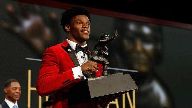 Louisville QB Lamar Jackson with the Heisman Trophy.