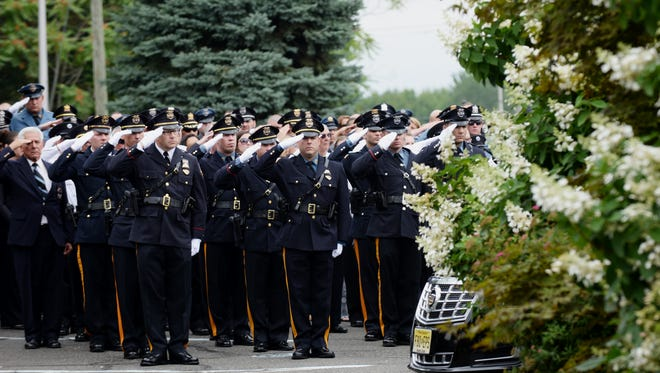 Police officers from across North Jersey salute Pompton Lakes Sgt. Peter Jay Kamper Jr., who was killed in a motorcycle accident early Wednesday. The funeral was held  in Wayne on Saturday.