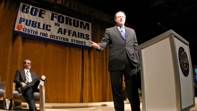 Al Gore addresses a capacity crowd at the 2007 Boe Forum on Public Affairs at the Elmen Center as Augustana president Rob Oliver looks on.