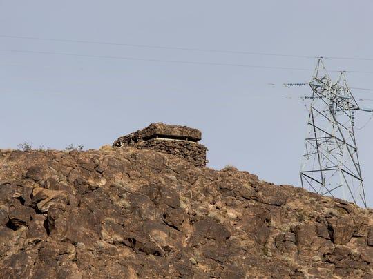 An abandoned World War II pillbox bunker sits on top