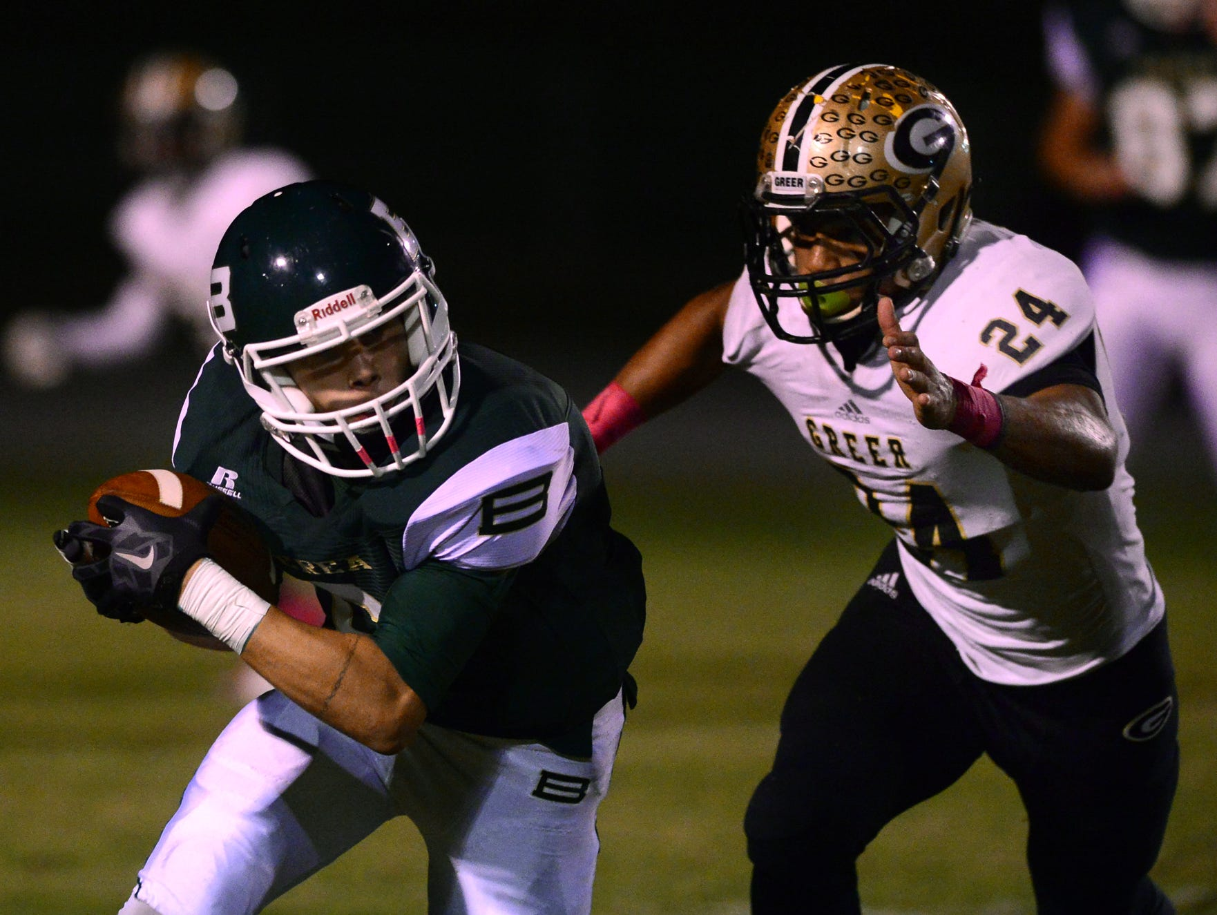 Greer High's Adrian McGee (24) tackles Berea's Tyler Landrum (6) at Berea on Friday, October 9, 2015.