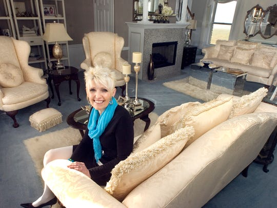 Professional decorator Judy Brillhart in the living room of her North Codorus Township home.