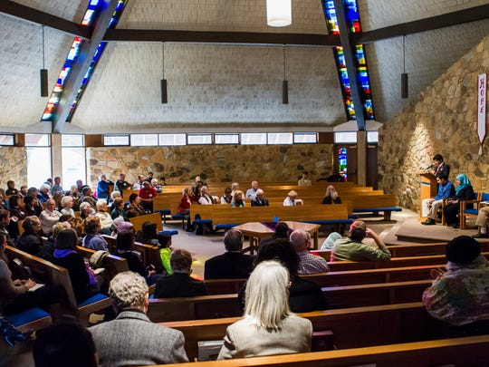 Dozens of people listen as Rumi Khan, a student at Newark Charter School, speaks at a panel discussion on Islamophobia in America at Silverside Church in Brandywine Hundred on Sunday afternoon.