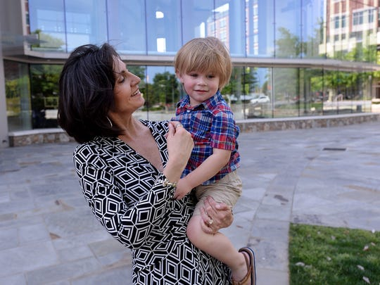 Leslie Blakely walks with her grandson Atley Godfrey outside the Peace Center in downtown Greenville on Wednesday.