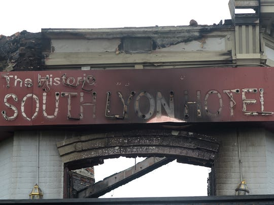 The facade of the South Lyon Hotel shows theeffects from an early morning fire on June 23.