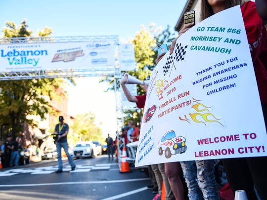 Spectators cheer as the Fireball Run Adventure Rally rolled into Lebanon on Tuesday, Sept. 27, 2016. Lebanon was the fourth stop on the eight-city, eight-day, 2,000-mile, life-sized trivia game that pits 40 rally teams against one another as they also spread awareness of missing children.