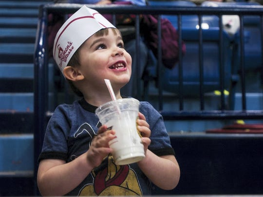 2014: Cadel Sommer, 3, of York, smiles after enjoying a milkshake in the small arena at the Pennsylvania Farm Show in Harrisburg.