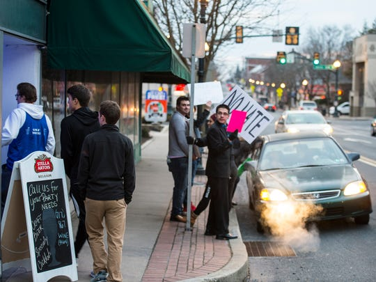 People head into Just Wing It in Annville as a group of 15 people protested outside of the restaurant on Sunday, Feb. 5, 2016 demanding Chris Behney, founder of Just Wing It, issue an apology after using a racial slur against an African American Lebanon Valley College student on Sunday, Jan. 22, 2016.