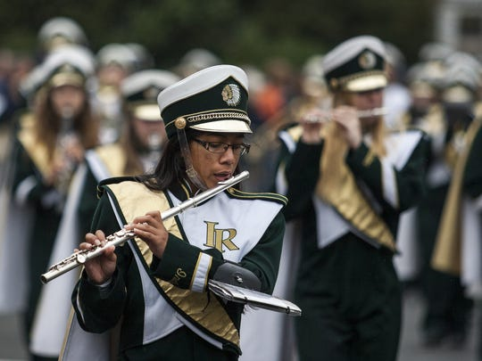 In this file photo, members of the Indian River High School band perform as they march in the Return Day parade through The Circle in Georgetown on Thursday afternoon, Nov. 6, 2014.