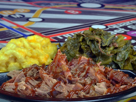 Smoked barbecue chopped pork with sides at Rhema Soul