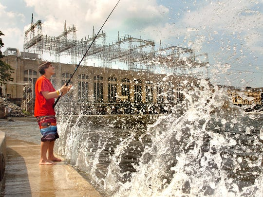 Justin Teague, 15, of Forest Hills, Md., fishes on the new wharf just below Conowingo Dam in Maryland in 2009, but doesn't mind the splashing on this 90-degree day.
