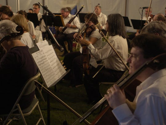 The Jackson Symphony performs during the Starlight Symphony on Saturday night on the First Presbyterian Church lawn.
