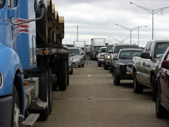 Eastbound traffic is stopped on I-10 in Lafayette following a crash. A large portion of the interstate between Lafayette and the Atchafalaya Basin is being widened.