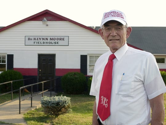Dr. H. Lynn Moore stands in front of the field house