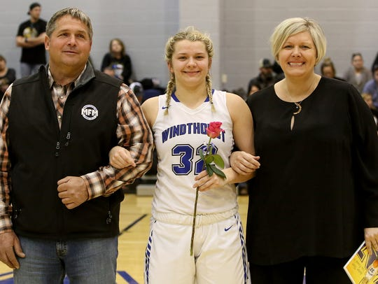 Windthorst's Tatum Veitenheimer stands with her parents