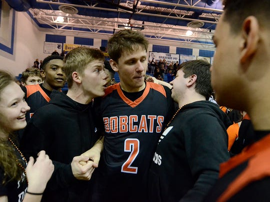 Northeastern's Nate Wilson, center, is surrounded by fans after the Bobcats beat Penncrest 63-60 in a PIAA second-round boys' basketball game in 2018. Wilson's first love is basketball, but he's chosen to play volleyball at Ohio State.