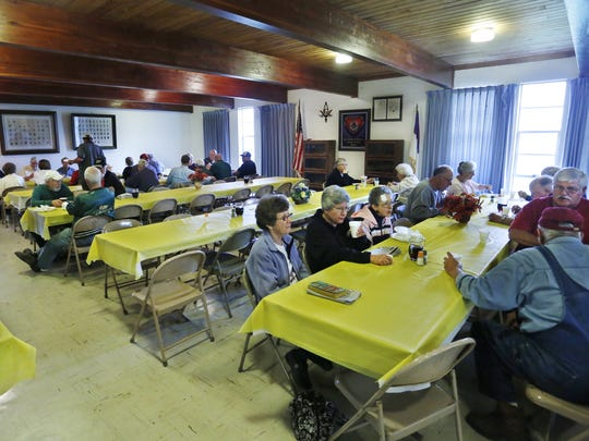 Guests enjoy conversation as the dine on biscuits and gravy, scrambled eggs, hasbrowns, sausage and pancakes during a community breakfast Saturday, September 13, 2014, at Dayton Masonic Lodge 103, 773 Walnut Street in Dayton. The lodge hosts a community breakfast the second Saturday each month.