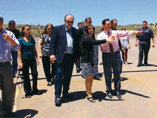 Following the ribbon-cutting ceremony for the Bayard Cemetery on Tuesday, officials took a tour of the property. Bayard Mayor Charles Kelly, center, joins Bayard Clerk/Treasurer Kristina Ortiz, who answers Sen. Howie  Morales´ questions about the area. Morales and former state Rep. Rodolpho ìRudyî Martinez, who was also in attendance, were instrumental in obtaining the 400,000 needed to help get the cemetery process started. Mary Alice Murphy   Sun-News