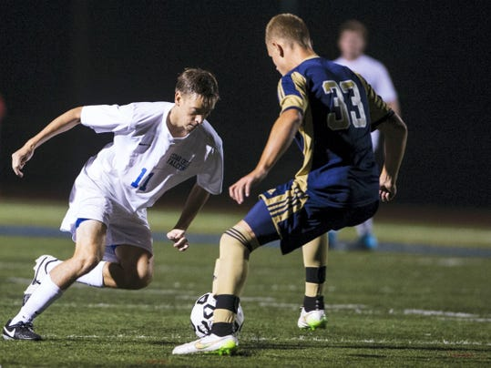 Cedar Crest's Cole Dumbauld and Elco's Joe Ginder battle for the ball during the Ritter-Hoffman Cup at Earl Boltz Stadium on Saturday night.